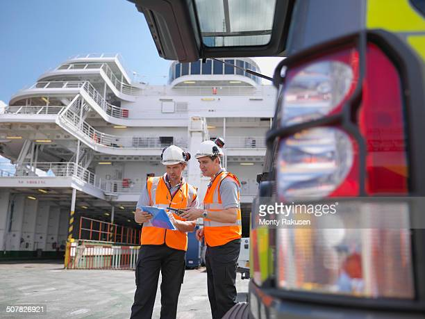 loading workers on deck of ferry - loader reading stock pictures, royalty-free photos & images