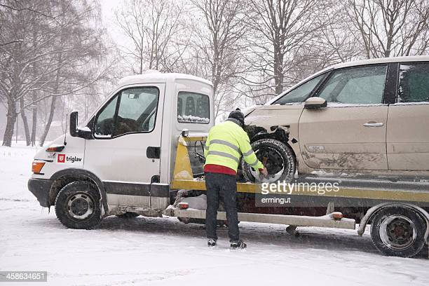 loading wrecked car on the truck - tow truck stock pictures, royalty-free photos & images