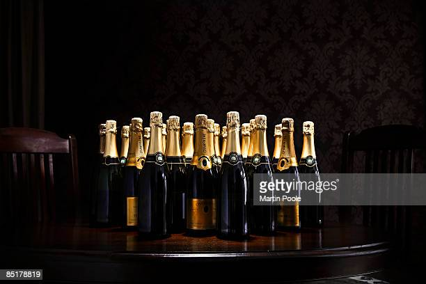 loads of champange bottles on living room  table - large group of objects stock pictures, royalty-free photos & images