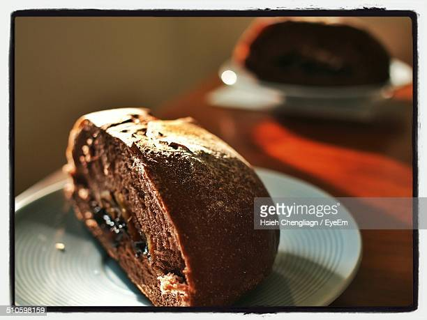 Loaf and slice of chocolate banana bread on plate