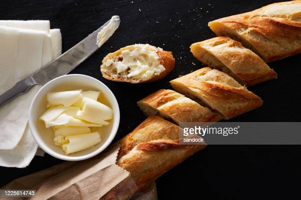 loaf of bread and butter - baguette stock pictures, royalty-free photos & images