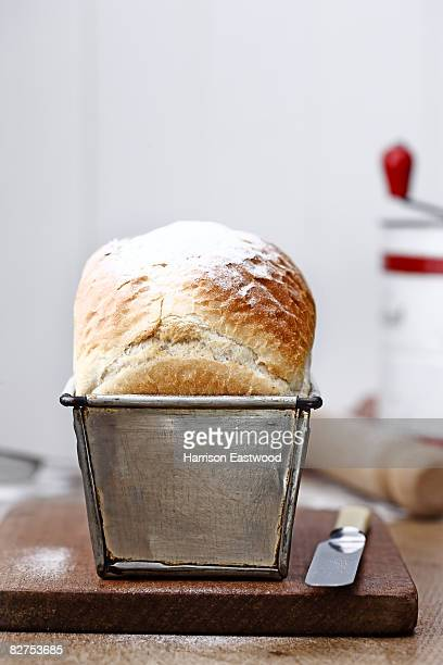 loaf of bread in bread tin on kitchen table - homemade stock pictures, royalty-free photos & images