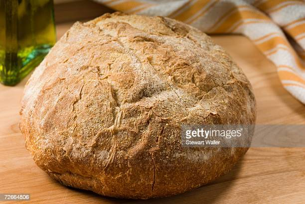 Loaf of bread on wooden bench