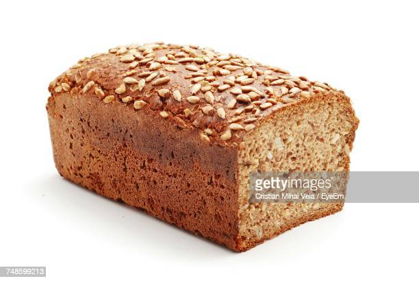 loaf of bread over white background - loaf of bread stock pictures, royalty-free photos & images