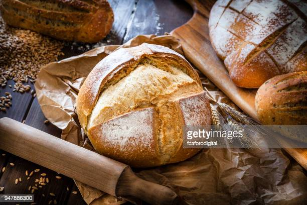 loaf of bread still life - baguette stock pictures, royalty-free photos & images