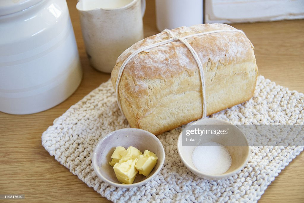 Loaf of bread with butter and salt : Foto de stock