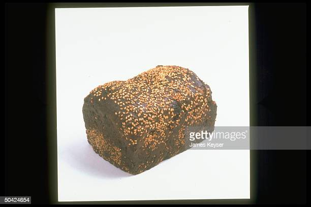 Loaf of dark bread covered w seeds