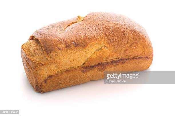A loaf of French brioche bread on white background