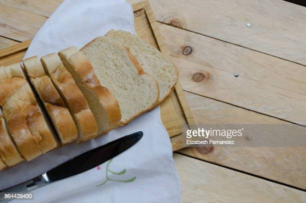 Loaf of sliced bread on a chopping board