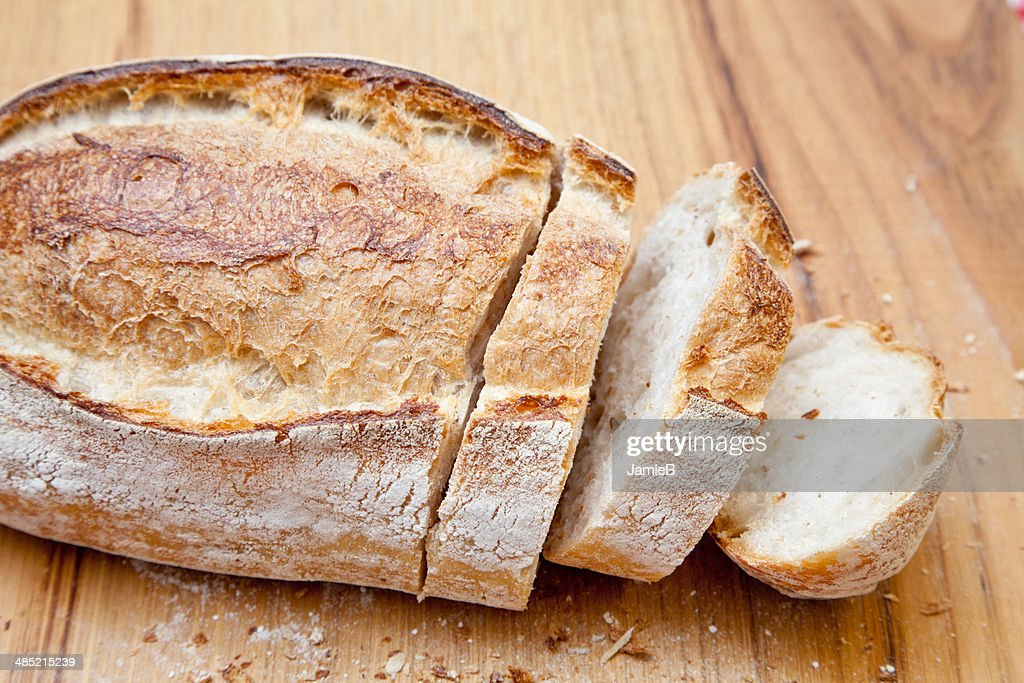 Loaf of sliced fresh bread : Stock Photo