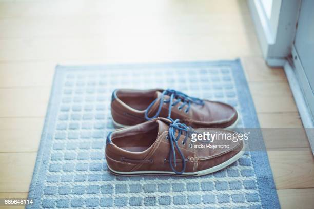 loafers for man on a carpet - linda wilton stock pictures, royalty-free photos & images