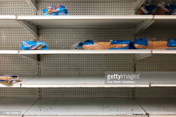 "Loafs of sliced bread are on display at one of the stores of the company ""Automercados Plaza's "" on April 4, 2019 in Caracas, Venezuela. Political..."