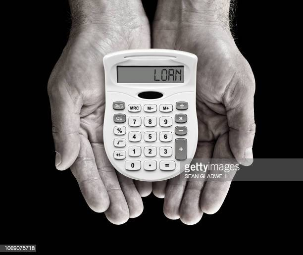 loan calculator - borrowing stock pictures, royalty-free photos & images