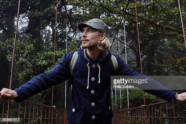 loan male traveller walking & exploring nature - guanacaste stock pictures, royalty-free photos & images