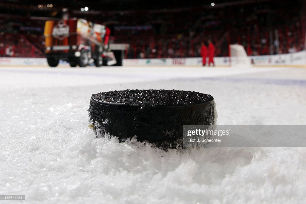 A loan puck sits on the ice while the Zamboni Ice Resurfacing machine makes the rounds prior to the start of the game between the Florida Panthers and the Carolina Hurricanes to the start at the BB&T Center on January 19, 2013 in Sunrise, Florida.