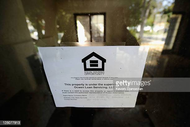 A loan servicing sign is posted on a foreclosed house on September 15 2011 in Glendale California Foreclosures spiked as mortgage default notices...