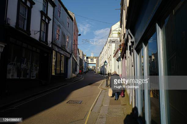 Loan shopper walks up the High Street on January 5, 2021 in Falmouth, United Kingdom. The British Prime Minister made a national television address...