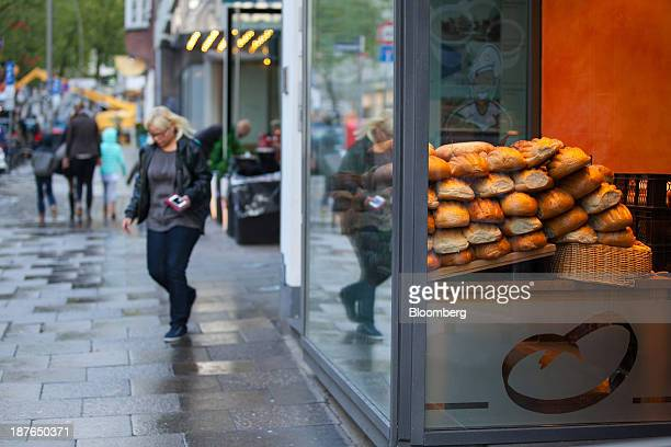 Loaves of bread sit on display in a bakery window as pedestrians pass in Hamburg Germany on Saturday Nov 9 2013 While Germany's economic strength...