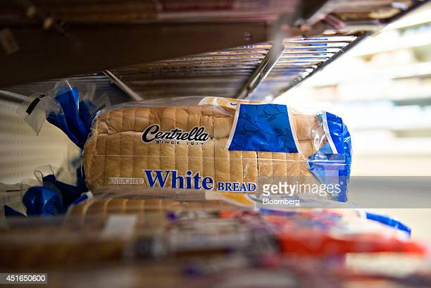 Loaves of Centrella brand white bread sit on display for sale in a supermarket in Princeton Illinois US on Wednesday July 2 2014 Rising prices for...