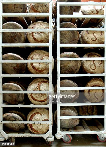 Loaves of fresh bread sit stacked in the bakery of the Pain Poilane factory in the suburb of Bievres in Paris France on Wednesday March 28 2007...