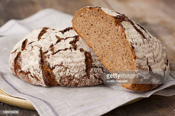 loaves of sourdough bread - loaf of bread stock pictures, royalty-free photos & images