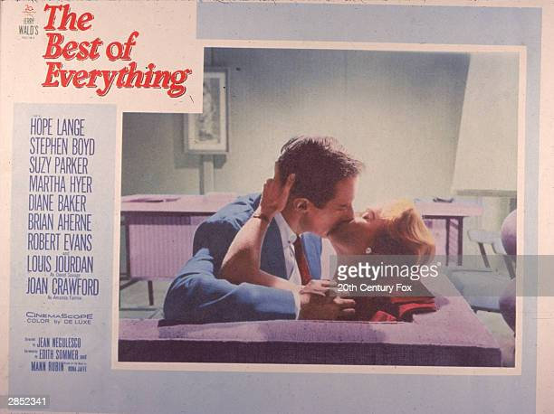 Lobby card depists a passionate kiss between Irish actor Stephen Boyd and American actor Hope Lange in a scene from 'The Best Of Everything' directed...