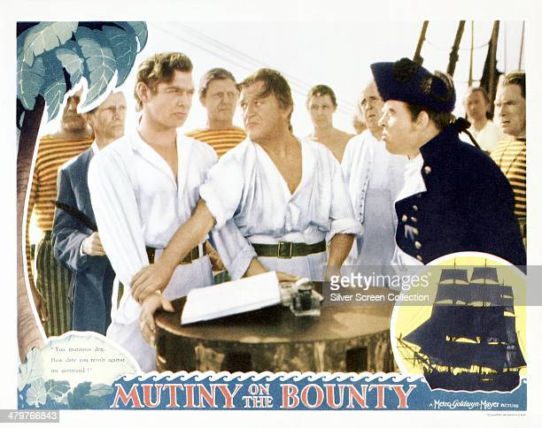 A lobby card for Frank Lloyd's 1935 historical drama 'Mutiny On The Bounty' starring Clark Gable as Fletcher Christian and Charles Laughton as...