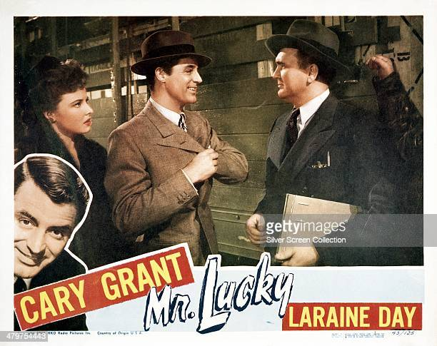 A lobby card for HC Potter's 1943 comedy 'Mr Lucky' starring Cary Grant and Laraine Day On the right is Emory Parnell as the dock watchman