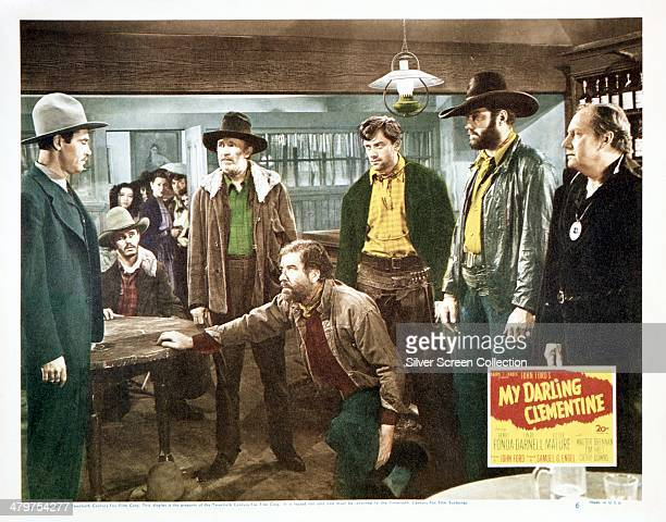 A lobby card for John Ford's 1946 western 'My Darling Clementine' starring Henry Fonda Left to right Fonda Walter Brennan Grant Withers John Ireland...