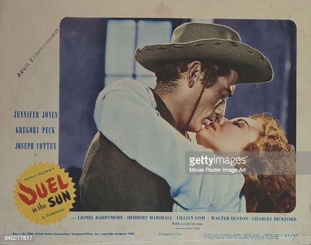 A lobby card for King Vidor's 1946 western 'Duel In The Sun' featuring Jennifer Jones and Gregory Peck