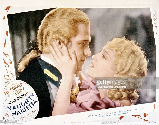 A lobby card for Robert Z Leonard and WS Van Dyke's 1935 musical 'Naughty Marietta' starring Nelson Eddy and Jeanette MacDonald
