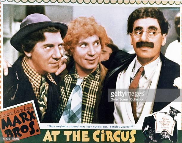 A lobby card for the 1939 Marx Brothers comedy 'At The Circus' directed by Edward Buzzell and starring Chico Harpo and Groucho Marx