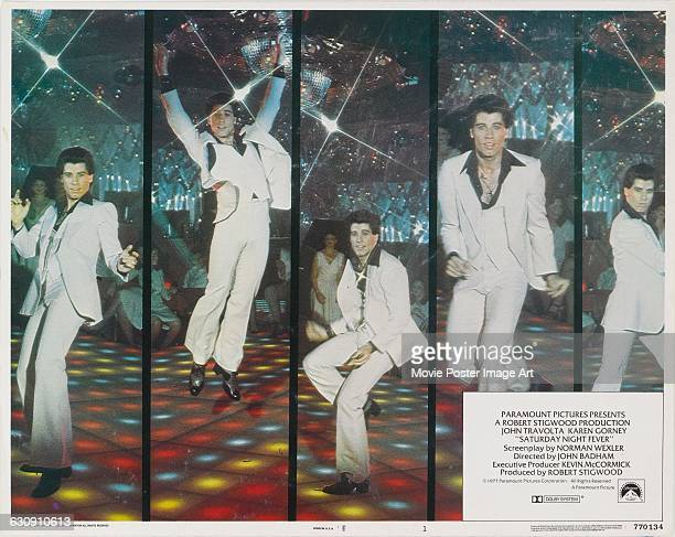 A lobby card for the 1977 US film 'Saturday Night Fever' featuring actor and dancer John Travolta The film was distributed by Paramount Pictures