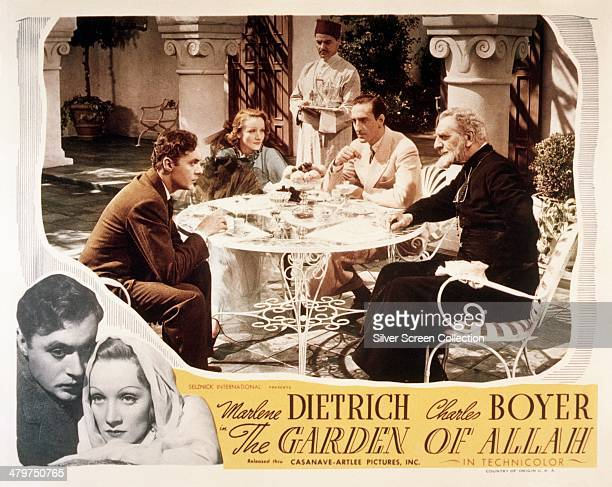 A lobby card for 'The Garden Of Allah' directed by Richard Boleslawski 1936 Sitting around the table are Charles Boyer Marlene Dietrich Basil...