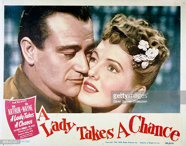 A lobby card for William A Seiter's 1943 romantic comedy 'A Lady Takes A Chance' starring Jean Arthur and John Wayne