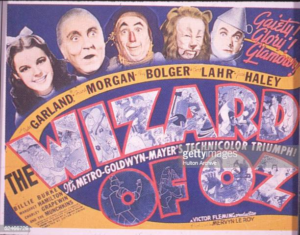 A lobby card from the film 'The Wizard Of Oz' features headshots of from left American actress Judy Garland and actors Frank Morgan Ray Bolger Bert...