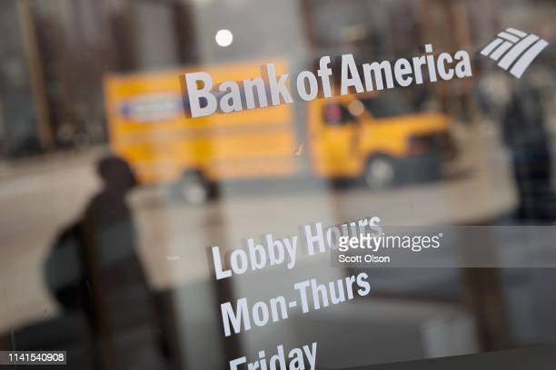 Lobby hours are posted on the entrance to a Bank of America branch in the Loop on April 09 2019 in Chicago Illinois The banking giant has announced...