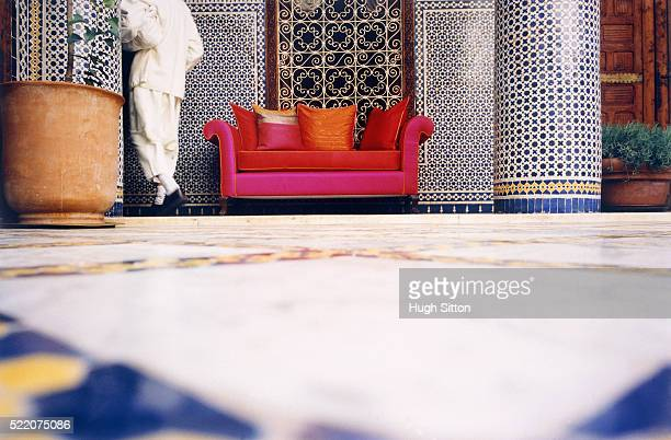 lobby of a hotel with pink sofa, morocco - hugh sitton stock pictures, royalty-free photos & images