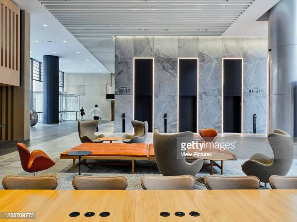 Lobby seating area and lifts. Sixty Martin Place, Sydney, Australia. Architect: HASSELL, 2019.