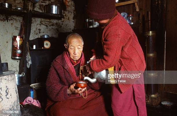 Lobsang Chotten a nun born in Tibet who left her country in 1959 with the Dalai Lama gets butter tea from her disciple at the Brandong Chung monastery
