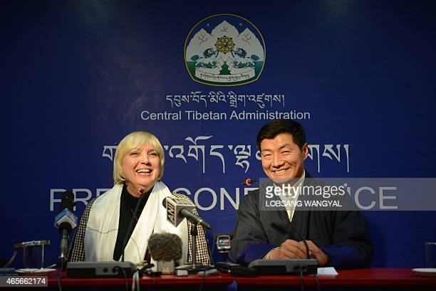 Lobsang Sangay leader of the exiled Central Tibetan Administration and Claudia Roth vice president of the German parliament share a light moment...