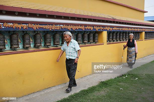 Lobsang Temba walks kora around the monastery in the Paljor Ling Refugee Camp on May 18, 2014 in Pokhara, Nepal. Temba joined Chushi Gangdruk as a...