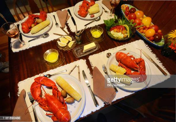 lobster and corn dinner for four - bo zaunders stock pictures, royalty-free photos & images