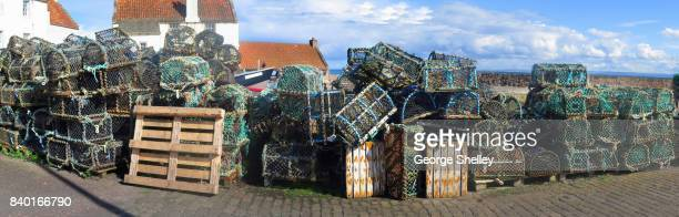 lobster and crab traps ona daock panoramic - crab pot stock photos and pictures