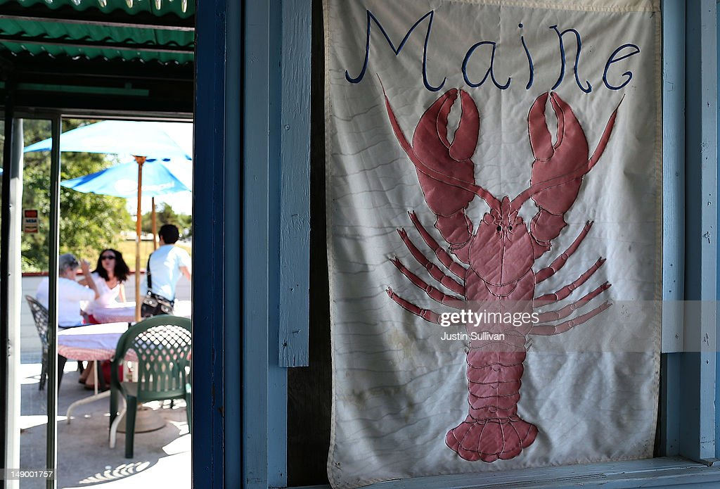 A lobster banner hangs in the doorway at Benny's Famous Fried Clams on July 21, 2012 in Portland, Maine. A mild winter and warmer than usual spring caused lobsters to shed their shells six weeks earlier than usual which resulted in an overabundance of lobsters in the Northeastern United States that has driven down prices to record lows. Lobstermen hope to make at least $4.00 a pound to turn a profit but prices this year have been as low as $1.25 a pound.