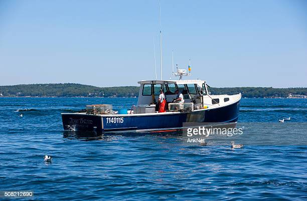 Lobster boat and two lobstermen in Maine
