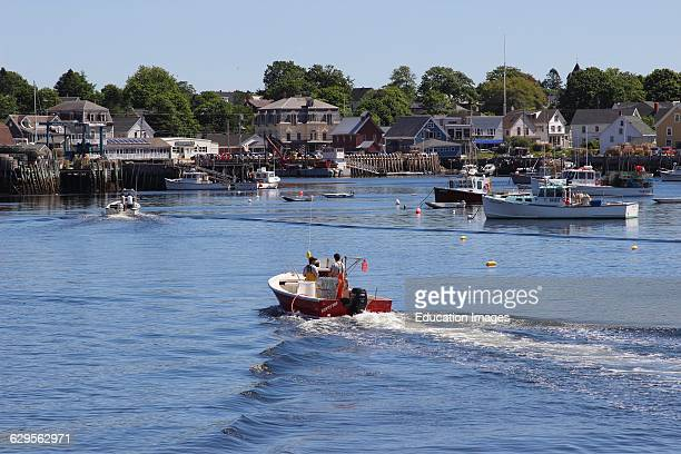 Lobster boat returning to dock waterfront Vinalhaven Island Maine New England USA