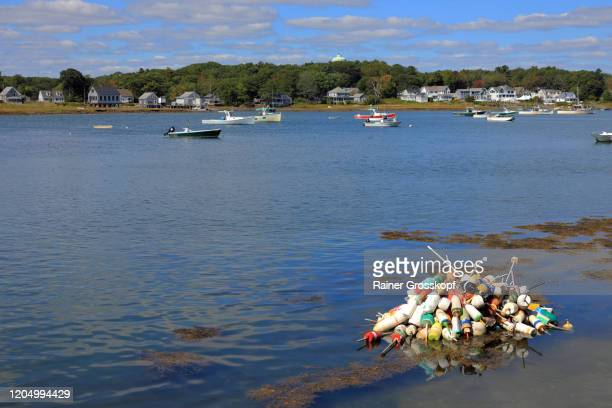 lobster bouys and fishing boats in a tranquil bay on the atlantic coast - rainer grosskopf fotografías e imágenes de stock