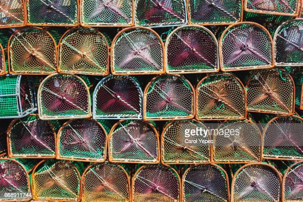lobster creels or pots background - lobster fishing stock photos and pictures