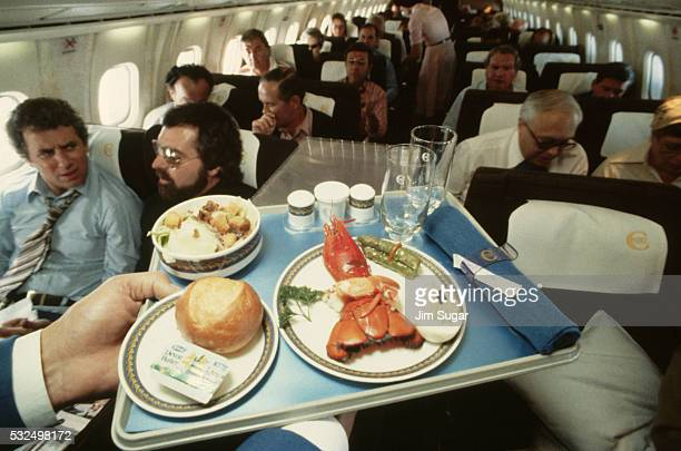 A lobster dinner on the Concorde as the plane flies over the Atlantic Ocean | Location Near the Atlantic Ocean